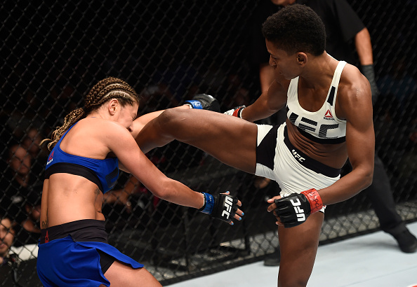 LAS VEGAS, NV - JULY 07: (R-L) Angela Hill kicks Ashley Yoder in their women's strawweight bout during The Ultimate Fighter Finale at T-Mobile Arena on July 7, 2017 in Las Vegas, Nevada. (Photo by Brandon Magnus/Zuffa LLC/Zuffa LLC via Getty Images)