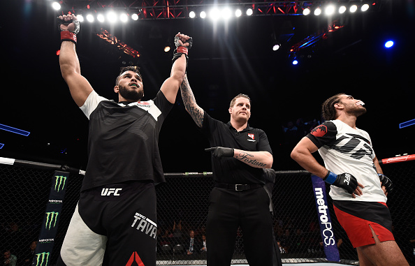 LAS VEGAS, NV - JULY 07: Brad Tavares celebrates after his unanimous-decision victory over Elias Theodorou of Canada in their middleweight bout during The Ultimate Fighter Finale at T-Mobile Arena on July 7, 2017 in Las Vegas, Nevada. (Photo by Brandon Magnus/Zuffa LLC/Zuffa LLC via Getty Images)