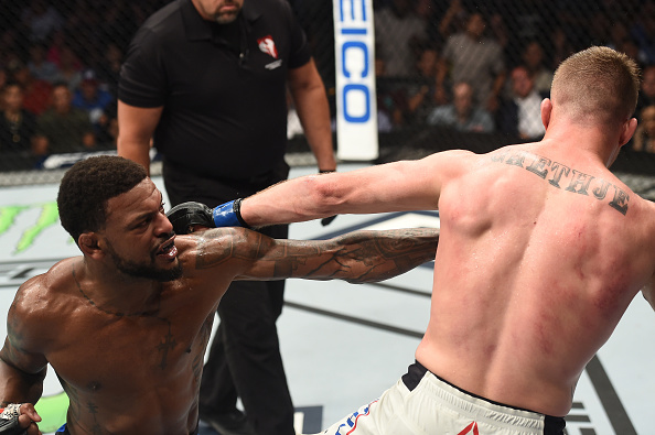 Michael Johnson punches Justin Gaethje during their bout at <a href='../event/Ultimate-Fighter-Team-Serra-vs-Team-Hughes-Finale'><a href='../event/The-Ultimate-Fighter-Team-US-vs-Team-UK-FINALE'><a href='../event/The-Ultimate-Fighter-Heavyweights-FINALE'>The Ultimate Fighter </a></a></a>in July of 2017