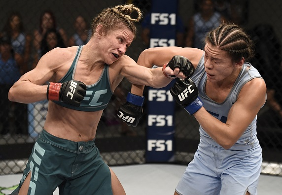 Barb Honchak punches Montano during their semifinal bout at The Ultimate Fighter
