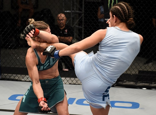 Nicco Montano kicks Barb Honchak during their semifinal matchup