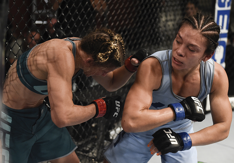 Nicco Montano elbows Barb Honchak during their quarterfinal fight on The Ultimate Fighter