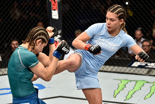 (R-L) <a href='../fighter/Nicco-Montano'>Nicco Montano</a> kicks <a href='../fighter/Roxanne-Modafferi'>Roxanne Modafferi</a> in their women's flyweight championship bout during the TUF Finale event inside Park Theater on December 01, 2017 in Las Vegas, Nevada. (Photo by Jeff Bottari/Zuffa LLC)