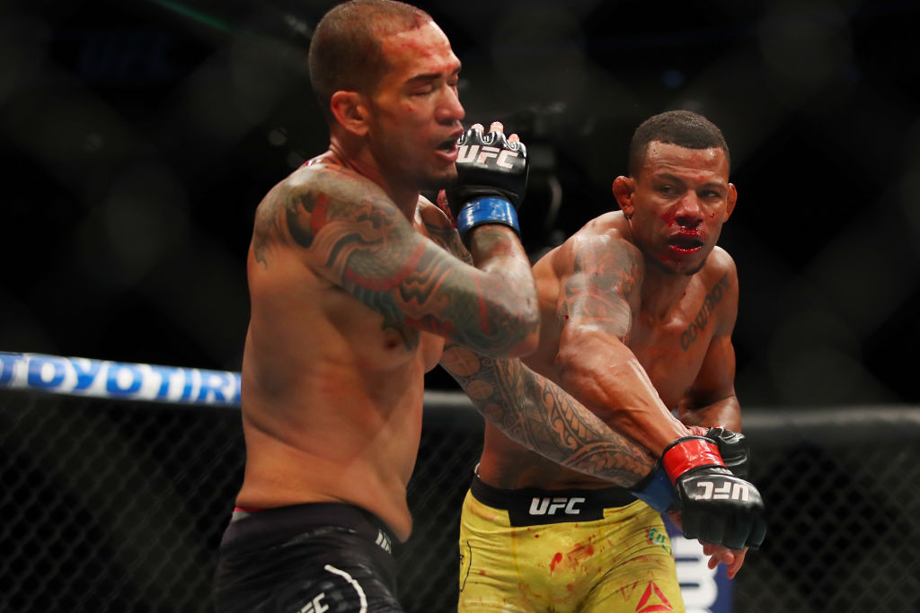 Yancy Medeiros (L) battles Alex Oliveira (R) during UFC 218 at Little Ceasars Arena on December 2, 2018 in Detroit, Michigan. (Photo by Gregory Shamus/Getty Images)