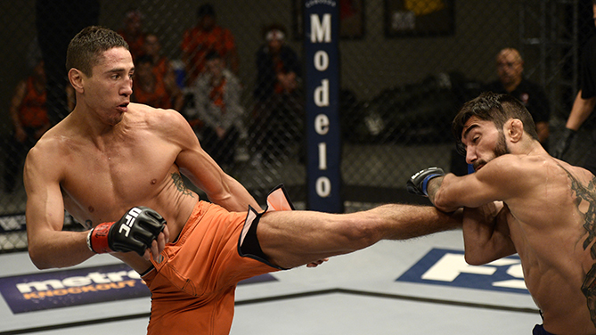 Steele kicks Mokhtarian during their bout on the previous episode of TUF