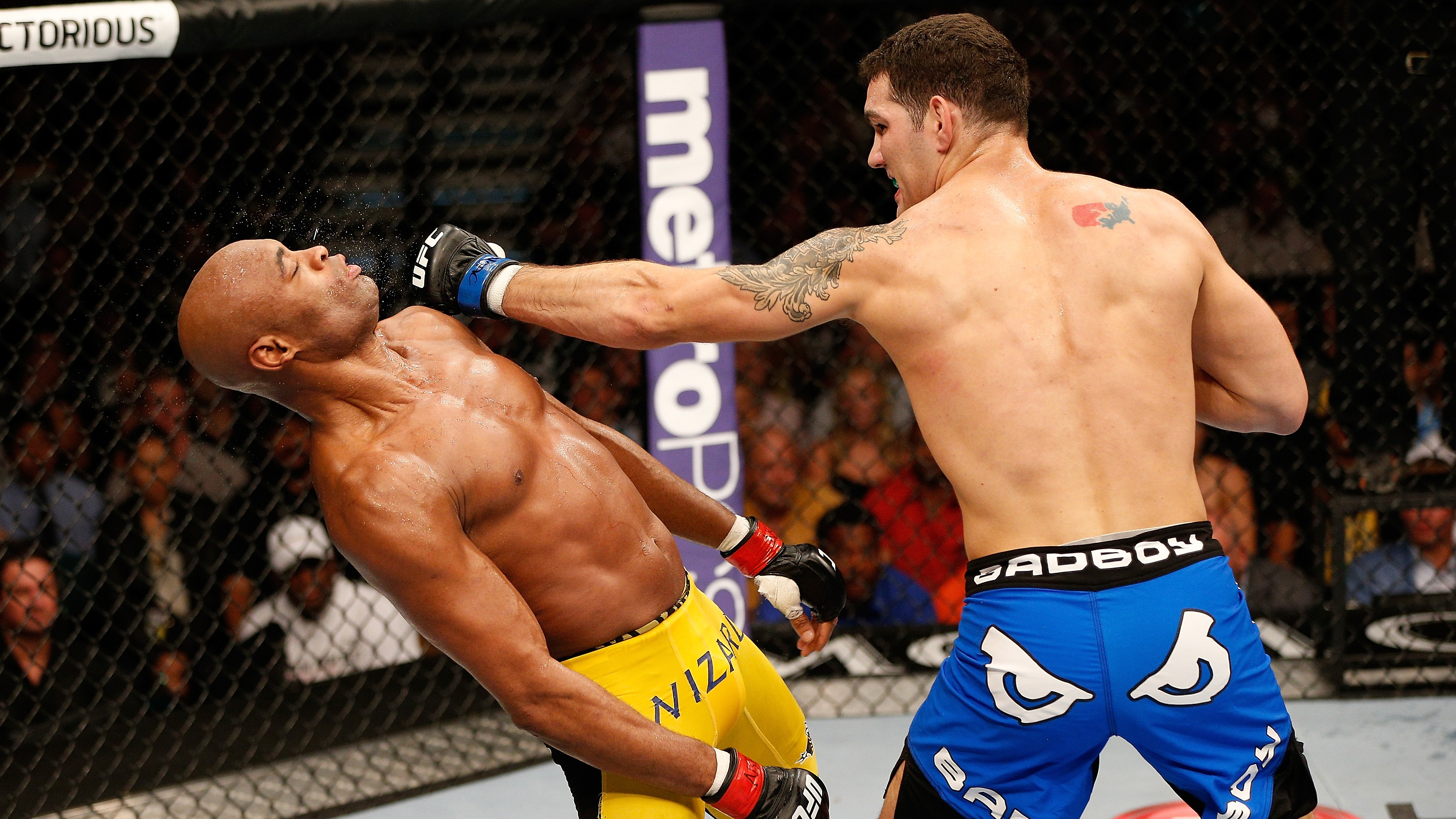 <a href='../fighter/Chris-Weidman'>Chris Weidman</a> punches <a href='../fighter/Anderson-Silva'>Anderson Silva</a> during his upset victory at UFC 162
