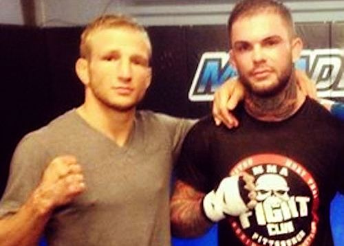Former teammates TJ Dillashaw (left) and Cody Garbrandt pose for a photo.