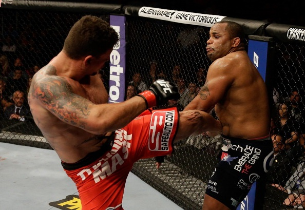 Mir kicks Cormier during their heavyweight bout