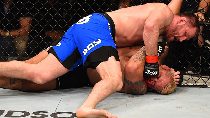 ADELAIDE, AUSTRALIA - MAY 10:   Stipe Miocic (top) punches Mark Hunt in their heavyweight bout during the UFC Fight Night event at the Adelaide Entertainment Centre on May 10, 2015 in Adelaide, Australia. (Photo by Josh Hedges/Zuffa LLC/Zuffa LLC via Getty Images)