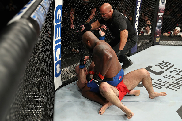 Derrick Lewis punches Shamil Abdurakhimov during their heavyweight bout at Fight Night Albany