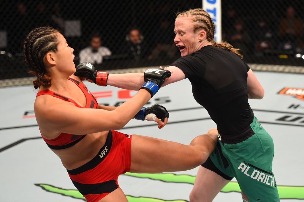 AUCKLAND, NEW ZEALAND - JUNE 11: (R-L) JJ Aldrich punches Chan-Mi Jeon of South Korea in their women's strawweight fight during the UFC Fight Night event at the Spark Arena on June 11, 2017 in Auckland, New Zealand. (Photo by Josh Hedges/Zuffa LLC)