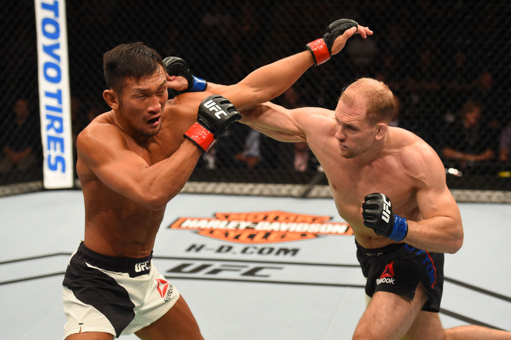 AUCKLAND, NEW ZEALAND - JUNE 11:  (R-L) Zak Ottow punches Kiichi Kunimoto of Japan in their welterweight fight during the UFC Fight Night event at the Spark Arena on June 11, 2017 in Auckland, New Zealand. (Photo by Josh Hedges/Zuffa LLC)