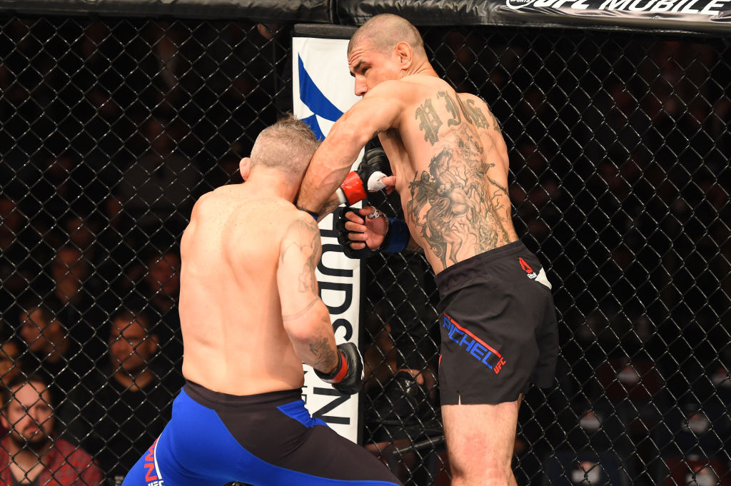 AUCKLAND, NEW ZEALAND - JUNE 11:  (R-L) Vinc Pichel punches Damien Brown of Australia in their lightweight fight during the UFC Fight Night event at the Spark Arena on June 11, 2017 in Auckland, New Zealand. (Photo by Josh Hedges/Zuffa LLC)