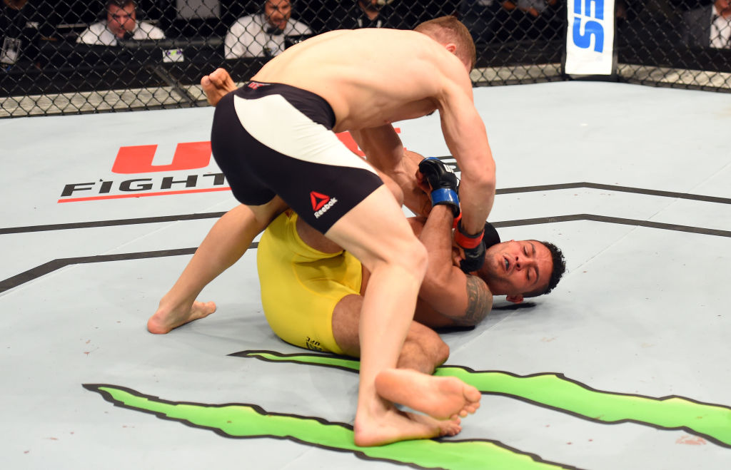 AUCKLAND, NEW ZEALAND - JUNE 11:  (L-R) Ion Cutelaba of Moldova punches Henrique da Silva of Brazil in their light heavyweight fight during the UFC Fight Night event at the Spark Arena on June 11, 2017 in Auckland, New Zealand. (Photo by Josh Hedges/Zuffa LLC)