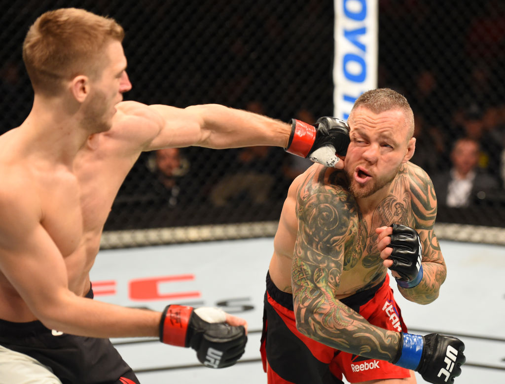 AUCKLAND, NEW ZEALAND - JUNE 11:  (L-R) Dan Hooker of New Zealand punches Ross Pearson of England in their lightweight fight during the UFC Fight Night event at the Spark Arena on June 11, 2017 in Auckland, New Zealand. (Photo by Josh Hedges/Zuffa LLC)