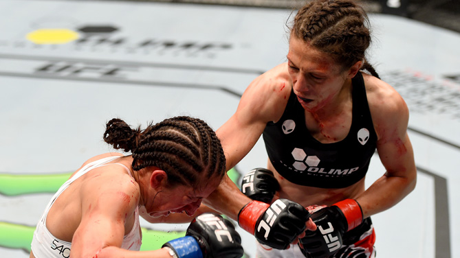 (R-L) Joanna Jedrzejczyk of Poland punches Jessica Penne of the United States in their women's strawweight championship bout during the UFC Fight Night event at the O2 World on June 20, 2015 in Berlin, Germany. (Photo by Josh Hedges/Zuffa LLC)