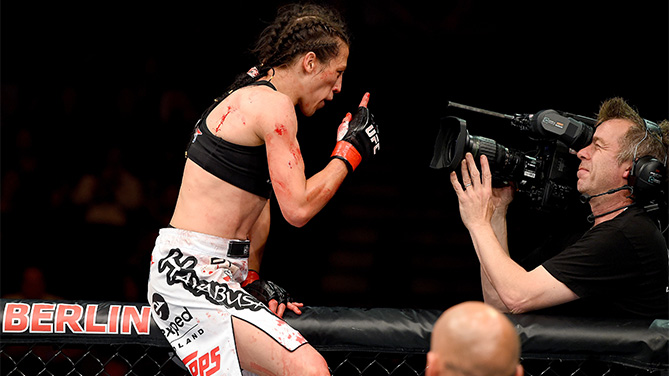 Joanna Jedrzejczyk of Poland celebrates after defeating Jessica Penne of the United States in their women's strawweight championship bout during the UFC Fight Night event at the O2 World on June 20, 2015 in Berlin, Germany. (Photo by Josh Hedges/Zuffa LLC)