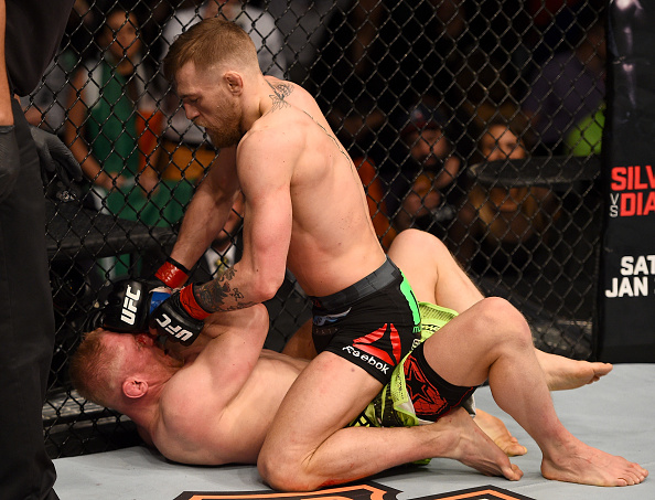 McGregor (top) landing punches on Siver.