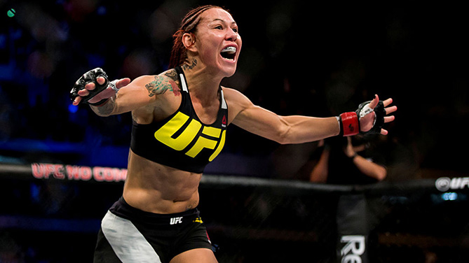 CURITIBA, BRAZIL - MAY 14: Cris 'Cyborg' Justino of Brazil celebrates after defeating Leslie Smith of the United States in their catchweight bout during the UFC 198 at Arena da Baixada stadium. (Photo by Buda Mendes/Zuffa LLC)