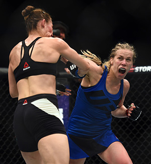 Chookagian punches Irene Aldana during their bout at UFC 210