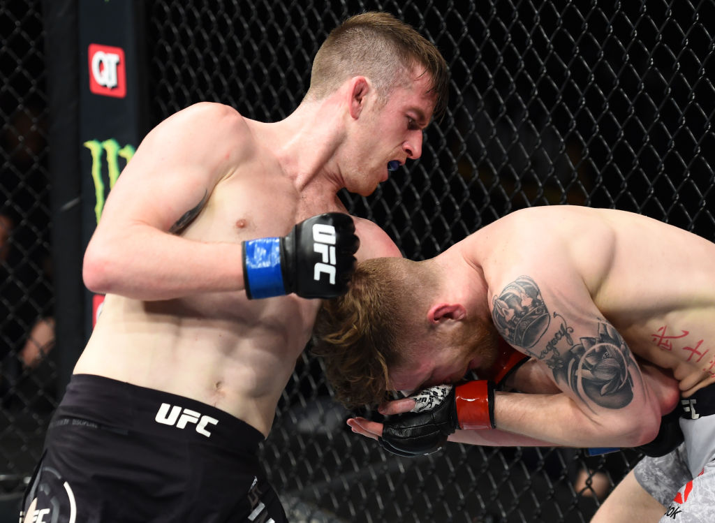 CHARLOTTE, NC - JANUARY 27: (L-R) Cory Sandhagen punches Austin Arnett in their featherweight bout during a UFC Fight Night event at Spectrum Center on January 27, 2018 in Charlotte, NC. (Photo by Josh Hedges/Zuffa LLC)