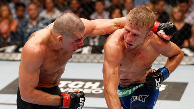 T.J. Dillashaw punches <a href='../fighter/Renan-Barao'><a href='../fighter/Renan-Barao'>Renan Barao</a></a> in their bantamweight championship bout during the UFC 173 event at the MGM Grand Garden Arena on May 24, 2014 in Las Vegas, Nevada. (Photo by Josh Hedges/Zuffa LLC)
