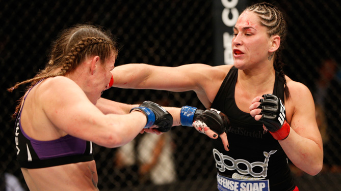 Jessica Eye punches Leslie Smith in their women's bantamweight fight during the UFC 180 event at the Arena Ciudad de Mexico on November 15, 2014 in Mexico City, Mexico. (Photo by Josh Hedges/Zuffa LLC)