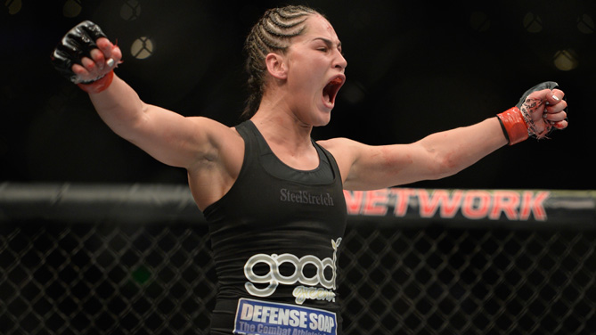 Jessica Eye celebrates after defeating <a href='../fighter/Leslie-Smith'>Leslie Smith</a> in their women's bantamweight bout during the UFC 180 event at Arena Ciudad de Mexico on November 15, 2014 in Mexico City, Mexico.  (Photo by Jeff Bottari/Zuffa LLC)