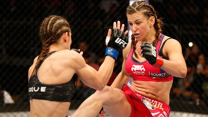 Miesha Tate kicks <a href='../fighter/Liz-Carmouche'>Liz Carmouche</a> in their women's bantamweight bout during the FOX UFC Saturday event at the Amway Center on April 19, 2014 in Orlando, Florida. (Photo by Josh Hedges/Zuffa LLC)