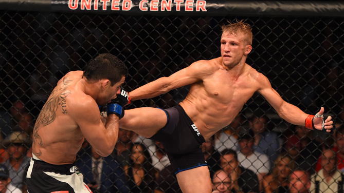 TJ Dillashaw kicks Renan Barao of Brazil in their UFC bantamweight championship bout during the UFC event at the United Center on July 25, 2015 in Chicago, Illinois. (Photo by Jeff Bottari/Zuffa LLC)