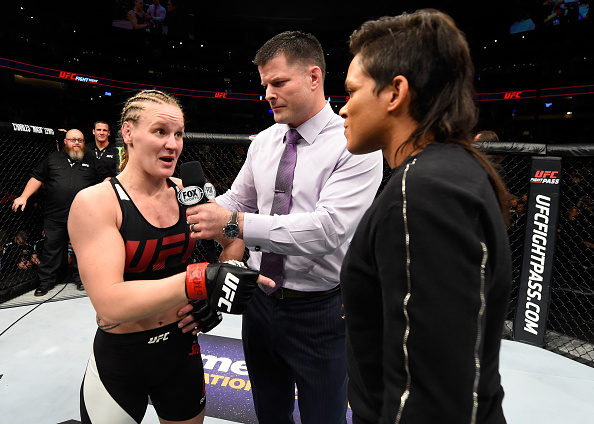DENVER, CO - JANUARY 28: (L-R) Valentina Shevchenko of Kyrgyzstan and UFC women's bantamweight champion Amanda Nunes speak to Brian Stan during the UFC Fight Night event at the Pepsi Center on January 28, 2017 in Denver, Colorado. (Photo by Josh Hedges/Zuffa LLC)
