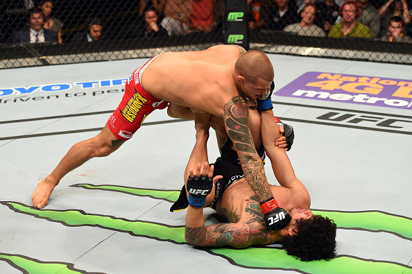 FAIRFAX, VA - APRIL 04: (L-R) Dustin Poirier punches Diego Ferreira in their lightweight fight during the UFC Fight Night event at the Patriot Center on April 4, 2015 in Fairfax, Virginia. (Photo by Josh Hedges/Zuffa LLC/Zuffa LLC via Getty Images)