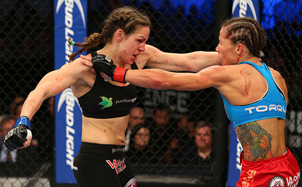 (L-R) Alexis Davis punches Liz Carmouche in their UFC women's bantamweight bout on November 6, 2013 in Fort Campbell, Kentucky. (Photo by Ed Mulholland/Zuffa LLC)