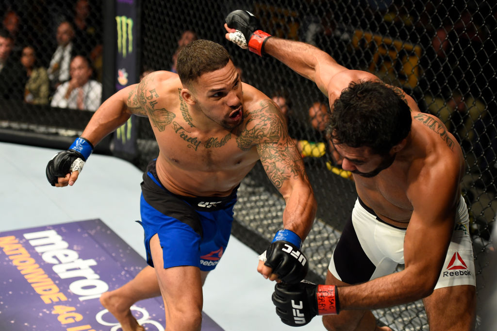 (L-R) Eryk Anders punches <a href='../fighter/rafael-natal'>Rafael Natal</a> of Brazil in their middleweight bout during the <a href='../event/UFC-Silva-vs-Irvin'>UFC Fight Night </a>event inside the Nassau Veterans Memorial Coliseum on July 22, 2017 in Uniondale, New York. (Photo by Josh Hedges/Zuffa LLC)