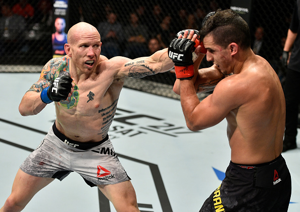 GDANSK, POLAND - OCTOBER 21: (L-R) Josh Emmett punches Felipe Arantes of Brazil in their featherweight bout during the UFC Fight Night event inside Ergo Arena on October 21, 2017 in Gdansk, Poland. (Photo by Jeff Bottari/Zuffa LLC)