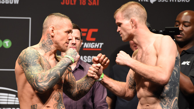 Opponents Ross Pearson of England and Evan Dunham of the United States face off during the UFC weigh-in inside the SSE Hydro on July 17, 2015 in Glasgow, Scotland. (Photo by Josh Hedges/Zuffa LLC)