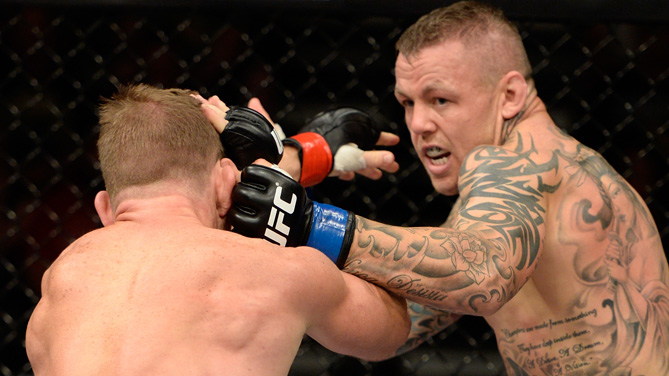 Ross Pearson punches Gray Maynard in their lightweight bout during the UFC fight night event at the Cross Insurance Center on August 16, 2014 in Bangor, Maine. (Photo by Jeff Bottari/Zuffa LLC)