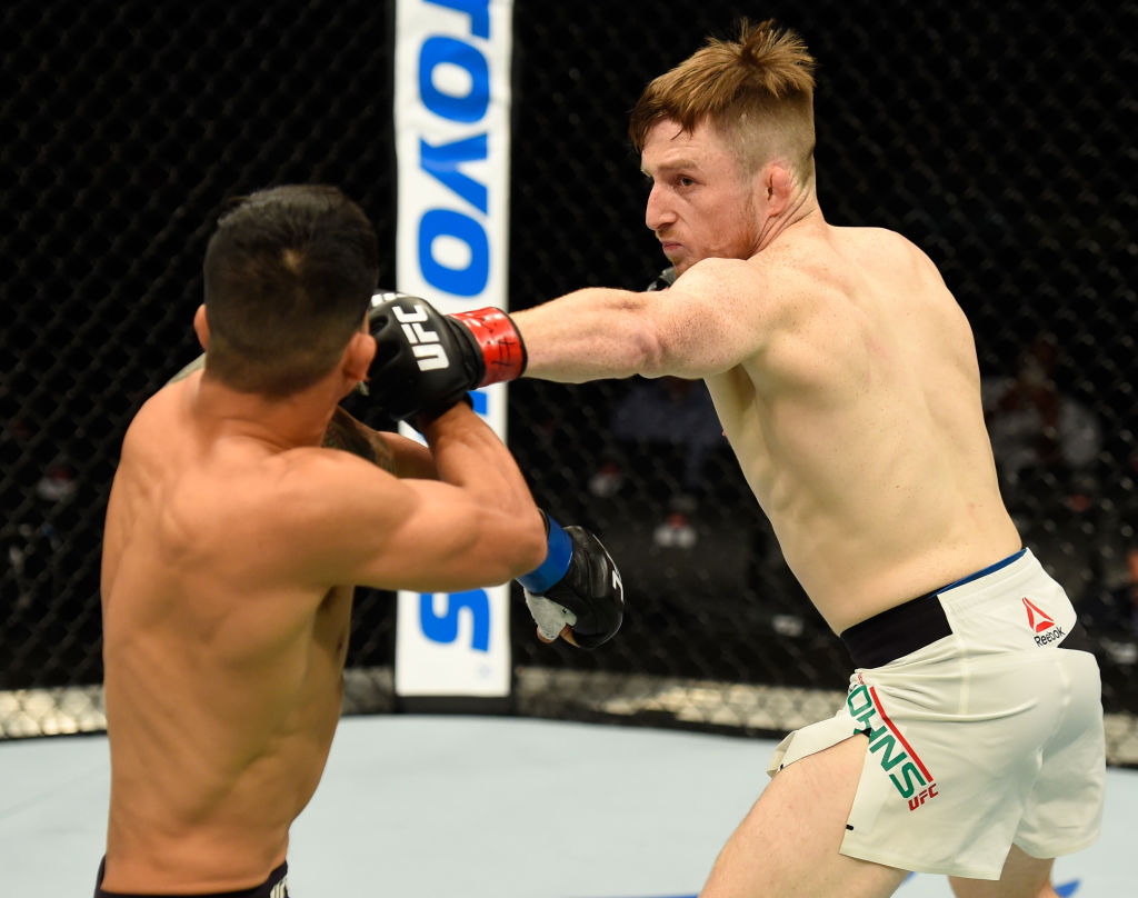 GLASGOW, SCOTLAND - JULY 16:  (R-L) Brett Johns of Wales punches Albert Morales in their bantamweight bout during the UFC Fight Night event at the SSE Hydro Arena Glasgow on July 16, 2017 in Glasgow, Scotland. (Photo by Josh Hedges/Zuffa LLC)
