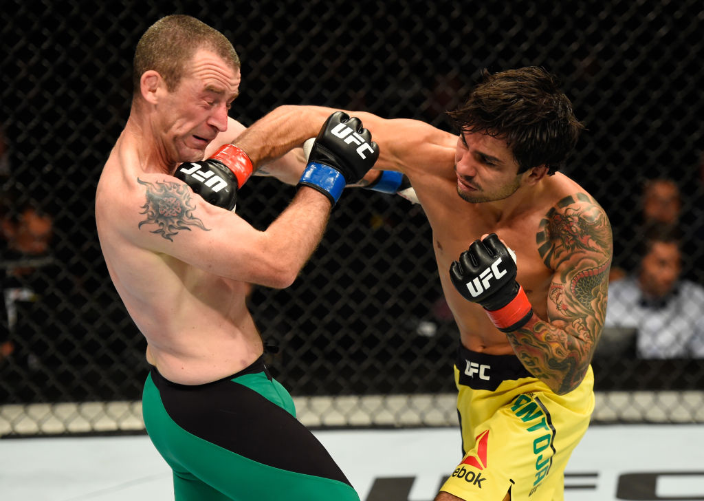 GLASGOW, SCOTLAND - JULY 16: (R-L) Alexandre Pantoja of Brazil punches Neil Seery of Ireland in their flyweight bout during the UFC Fight Night event at the SSE Hydro Arena Glasgow on July 16, 2017 in Glasgow, Scotland. (Photo by Josh Hedges/Zuffa LLC)
