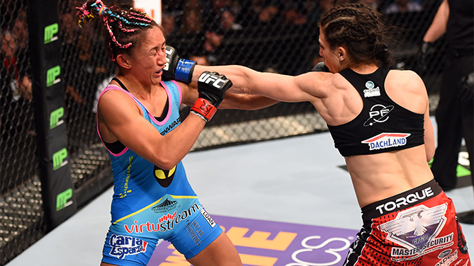 DALLAS, TX - MARCH 14: (R-L) Joanna Jedrzejczyk punches Carla Esparza in their UFC women's strawweight championship bout during the UFC 185 event at the American Airlines Center on March 14, 2015 in Dallas, Texas. (Photo by Josh Hedges/Zuffa LLC/Zuffa LLC via Getty Images)