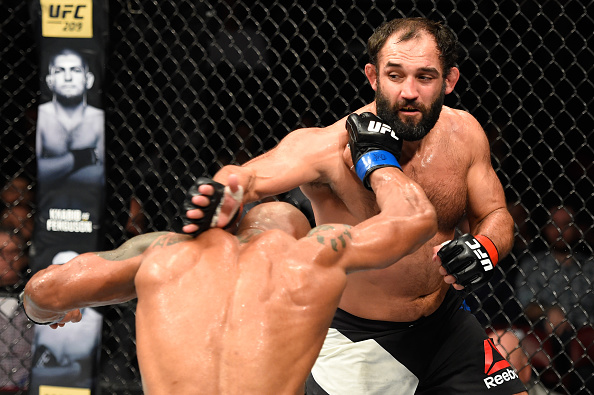<a href='../fighter/Johny-Hendricks'>Johny Hendricks</a> punches <a href='../fighter/Hector-Lombard'>Hector Lombard</a> during his 185-pound debut victory in Halifax