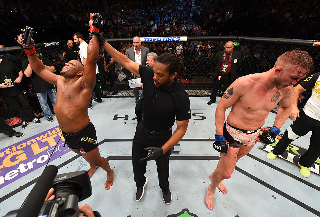 HOUSTON, TX - OCT. 03:  (L-R) Daniel Cormier celebrates his victory over Alexander Gustafsson in their UFC light heavyweight championship bout during the UFC 192 event at the Toyota Center. (Photo by Josh Hedges/Zuffa LLC)