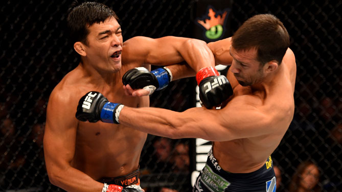 Luke Rockhold and Lyoto Machida of Brazil exchange blows in their middleweight bout during the UFC Fight Night event at Prudential Center on April 18, 2015 in Newark, New Jersey.  (Photo by Josh Hedges/Zuffa LLC)