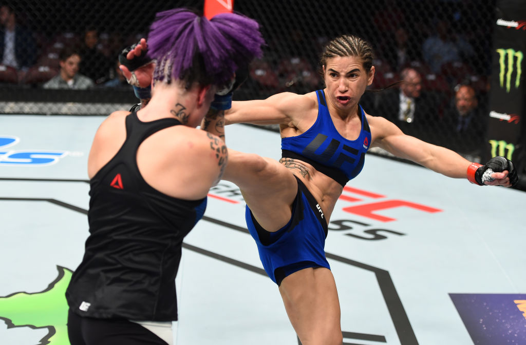Tecia Torres kicks Bec Rawlings of Australia in their women's strawweight bout. (Photo by Jeff Bottari/Zuffa LLC/Zuffa LLC via Getty Images)