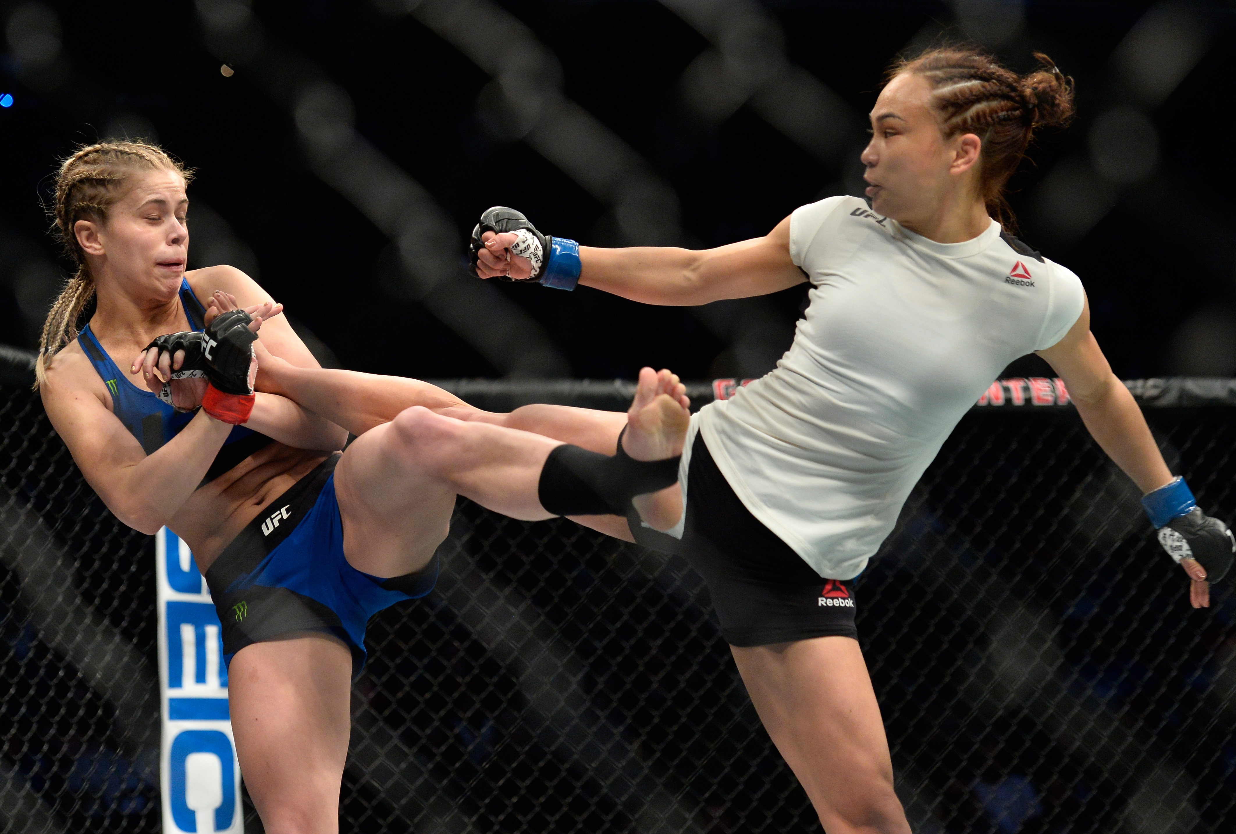 Michelle Waterson kicks Paige VanZant during their Fight Night bout in December