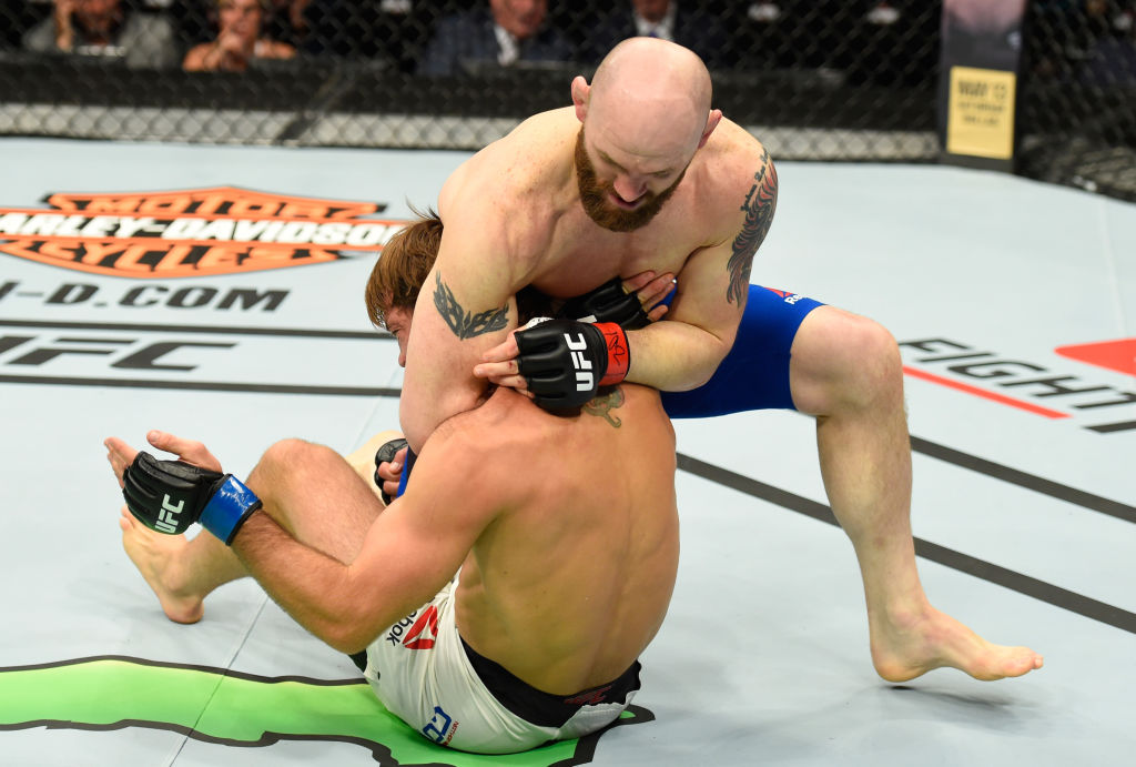 KANSAS CITY, MO - APRIL 15: (R-L) Zak Cummings attempts to submit Nathan Coy in their welterweight fight during the UFC Fight Night event at Sprint Center on April 15, 2017 in Kansas City, Missouri. (Photo by Josh Hedges/Zuffa LLC)