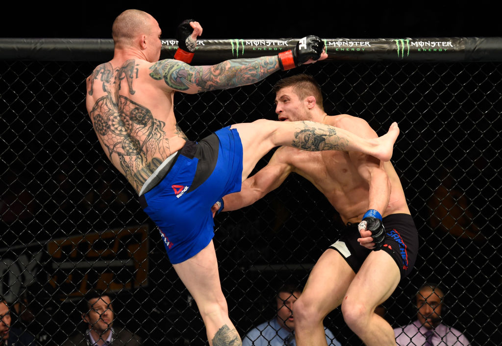 (L-R) Anthony Smith kicks <a href='../fighter/andrew-sanchez'>Andrew Sanchez</a> in their middleweight fight during the UFC Fight Night event at Sprint Center on April 15, 2017 in Kansas City, Missouri. (Photo by Josh Hedges/Zuffa LLC)