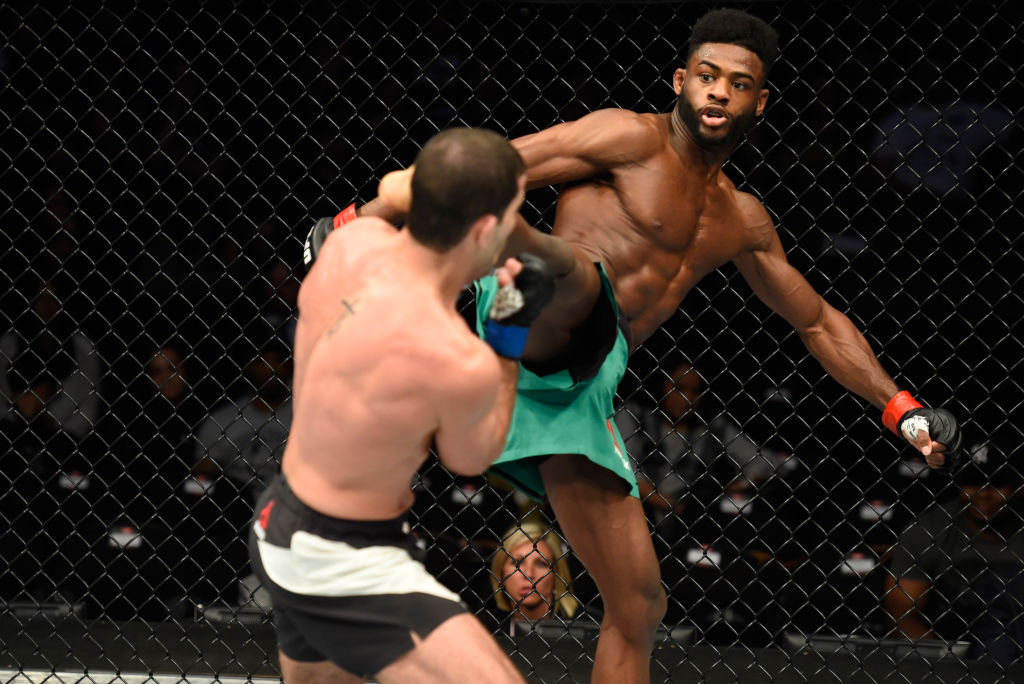 KANSAS CITY, MO - APRIL 15: (R-L) Aljamain Sterling kicks Augusto Mendes of Brazil in their bantamweight fight during the UFC Fight Night event at Sprint Center on April 15, 2017 in Kansas City, Missouri. (Photo by Josh Hedges/Zuffa LLC)