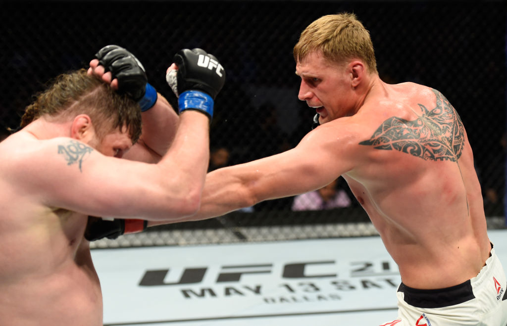 KANSAS CITY, MO - APRIL 15:  (R-L) Alexander Volkov of Russia punches Roy Nelson in their heavyweight fight during the UFC Fight Night event at Sprint Center on April 15, 2017 in Kansas City, Missouri. (Photo by Josh Hedges/Zuffa LLC)