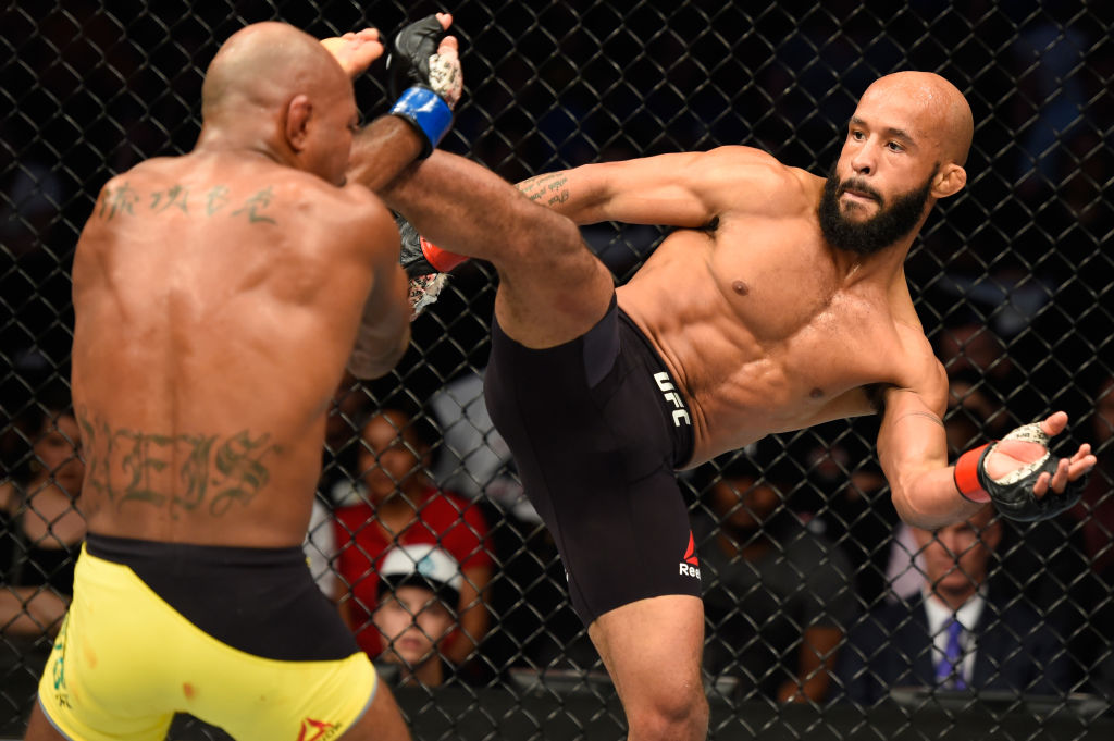KANSAS CITY, MO - APRIL 15:  (R-L) Demetrious Johnson kicks Wilson Reis of Brazil in their UFC flyweight fight during the UFC Fight Night event at Sprint Center on April 15, 2017 in Kansas City, Missouri. (Photo by Josh Hedges/Zuffa LLC)